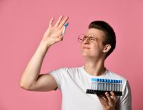 Young scientist holding a test tube royalty free stock image