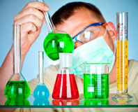 Young scientist in laboratory with test tubes Royalty Free Stock Photography