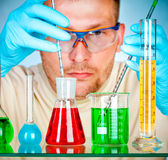 Young scientist in laboratory with test tubes Stock Image