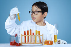 Young scientist looking at chemical fluid Stock Photo