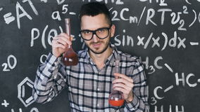 Young scientist man make laboratory experiment in chemical and mathematical equations wall room. Young scientist man posing in chemical and mathematical stock footage