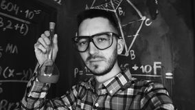 Young scientist man making selfie shoot in chemical and mathematical equations wall room interior. Young scientist man posing in chemical and mathematical Stock Images