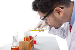 Young scientist mixing chemical liquid Royalty Free Stock Photos