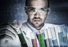 Young scientist mixing reagents in glass flask in clinical laboratory Stock Photography