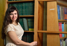 A young scientist n the library Royalty Free Stock Photography