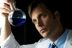 Young Scientist Performing Experiment Royalty Free Stock Photography
