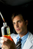 Young Scientist Performing Experiment Stock Photography