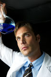 Young Scientist Performing Experiment stock images