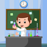 Young scientist points to chalkboard and smiling Royalty Free Stock Photos