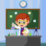 Young scientist points to chalkboard and smiling Stock Images