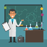 Young scientist points to chalkboard and smiling Stock Photography