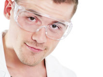 Young scientist in protective goggles Stock Photo