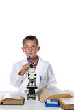 Young scientist putting his pen to his chin Stock Photography