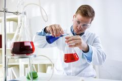 Young scientist research chemistry test in laboratory royalty free stock photography