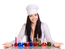Young scientist at the table with test tubes Stock Images