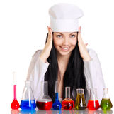 Young scientist at the table with test tubes Royalty Free Stock Images
