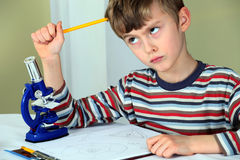 Young scientist thinking Royalty Free Stock Images
