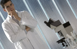 Young scientist thinking in his lab Stock Image