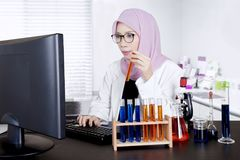 Young scientist using computer in the lab Stock Photo