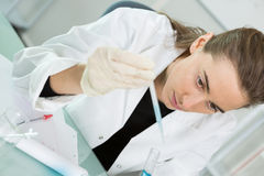 Young scientist using pipette in molecular biology lab Stock Photo