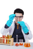 Young scientist working with chemical. Portrait of male scientist doing experiment by mixing chemical, isolated on white Stock Photography