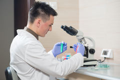 Young scientist working with liquid materials Royalty Free Stock Photos