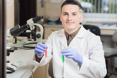 Young scientist working with liquid materials Stock Photo