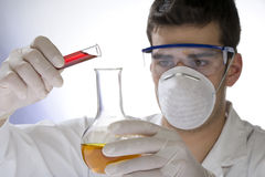Young scientist working with mask Royalty Free Stock Photography