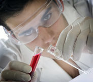 Young scientist working with mask stock photos