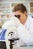 Young scientist working with microscope Royalty Free Stock Photography
