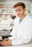Young scientist working with microscope Stock Photography