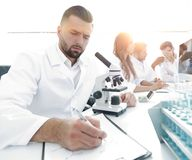 Young scientist works in the lab. Concept of teamwork Royalty Free Stock Photo