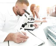 Young scientist works in the lab. Concept of teamwork Stock Photos
