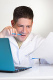 Young scientist works with laptop or netbook Royalty Free Stock Image