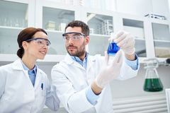 Young scientists making test or research in lab Royalty Free Stock Photo