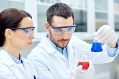Young scientists making test or research in lab Stock Photos