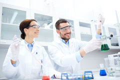 Young scientists making test or research in lab Royalty Free Stock Photos