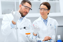 Young scientists making test or research in lab Stock Images
