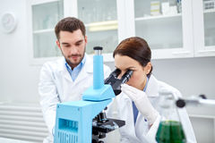 Young scientists making test or research in lab Royalty Free Stock Photography