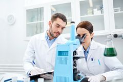 Young scientists making test or research in lab Stock Image