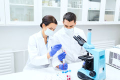 Young scientists making test or research in lab Stock Photography