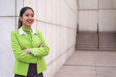 Young scort woman or crew smiling crossed arms green royalty free stock photos