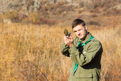 Young scout navigating using a compass Royalty Free Stock Photo