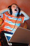Young screaming kid with headphones Stock Image
