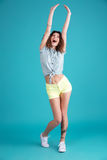 Young screaming woman standing isolated Stock Photography