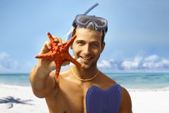 Young scuba diver with sea star Stock Photos