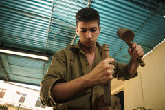 Young Sculptor Artist Working And Sculpting Wood Statue Stock Photos