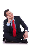 Young seated business man looking up Royalty Free Stock Photography