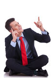 Young seated business man pointing Stock Image