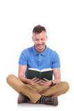 Young seated man reads his book Stock Photo